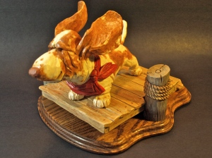 """Fergus"" the Basset Hound and the dock on which he's standing is made of basswood and painted in acrylics with a clear urethane finish. The base beneath the dock and piers is made of oak."
