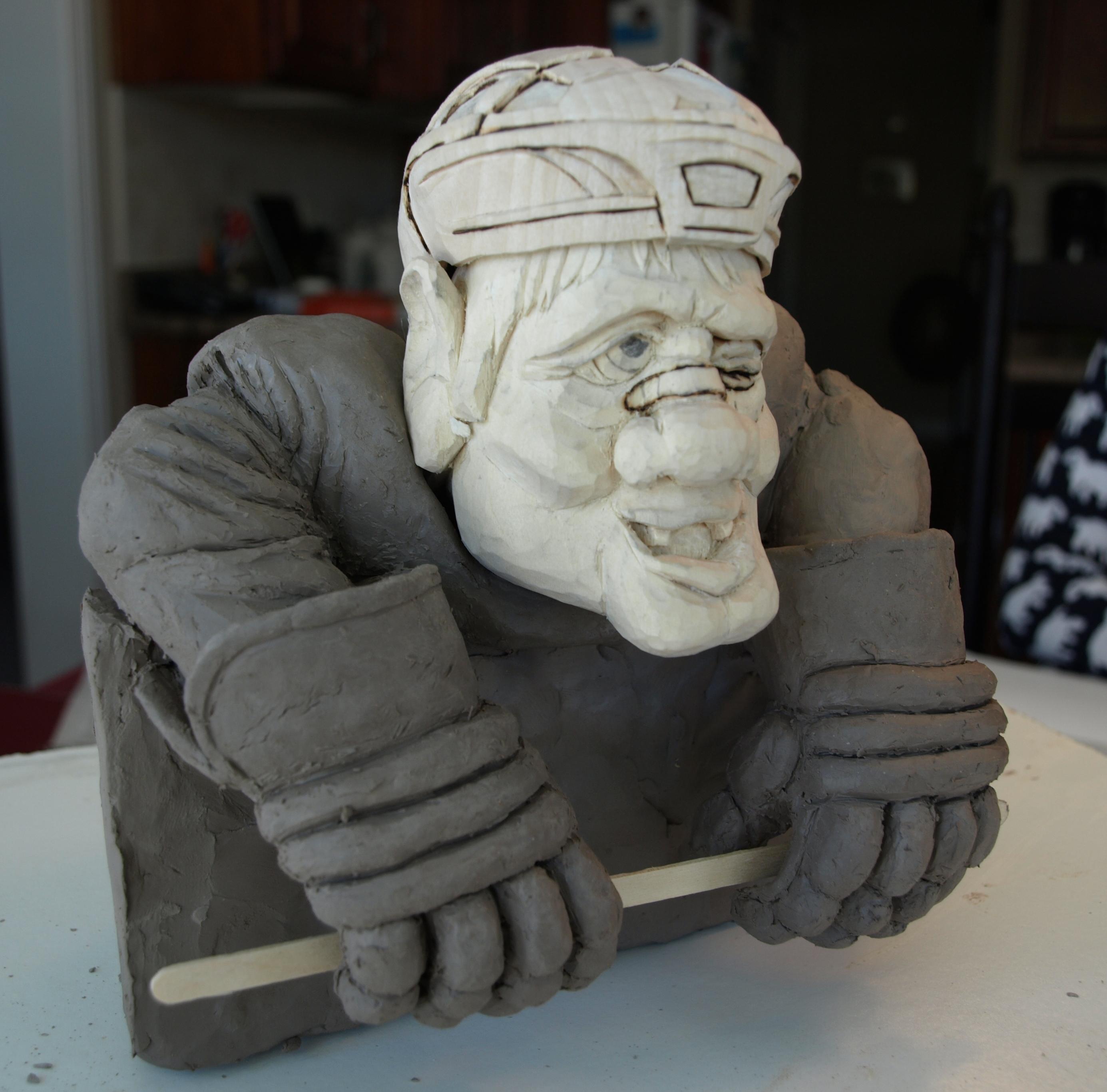 Hockey player carving tributesinwood